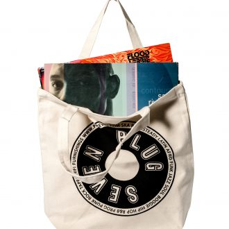 tote bag full with records